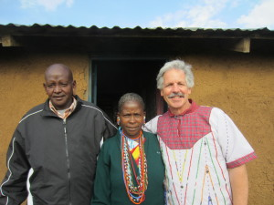 Kikanae's teacher and mentor, David Weeks, with Kikanae's parents. Kikanae's mother made the shirt that Mr. Weeks is wearing.